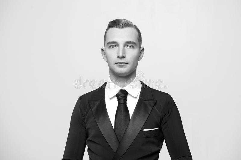 Confident attractive young man in tuxedo. Portrait of Confident attractive handsome ballroom dancer young man in tuxedo isolated on grey background, black and stock photos