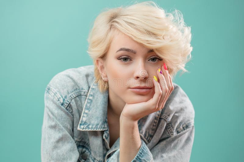 Confident awesome blond girl with pensive look royalty free stock photos