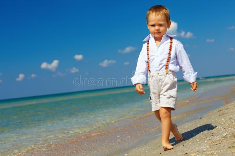 Confident baby boy goes forward firm gait stock photos