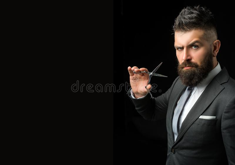 Confident barber at barbershop. Barber and hairdresser salon. Beard care, perfect beard. Bearded man in formal business royalty free stock photo