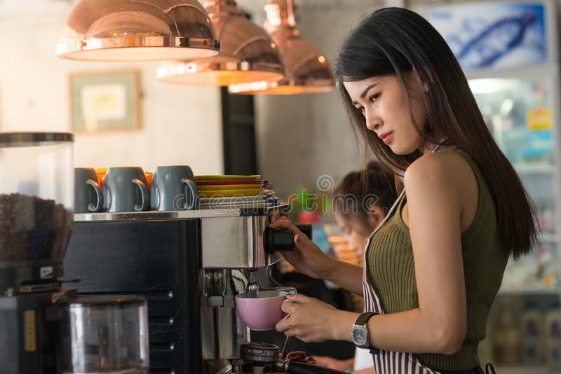 Confident barista. Young asian entrepreneur stock photo