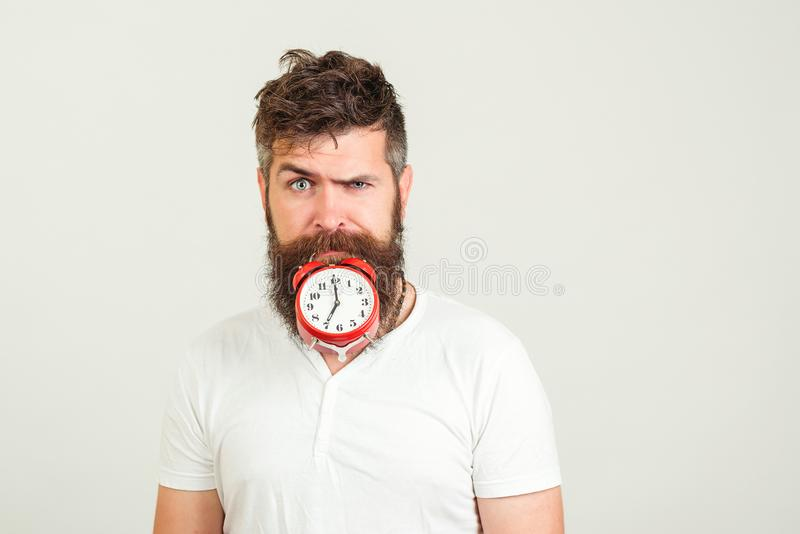 Confident bearded hipster man with clock. Start planning day. Brutal bearded man make progress. Successful bearded man has a time royalty free stock images