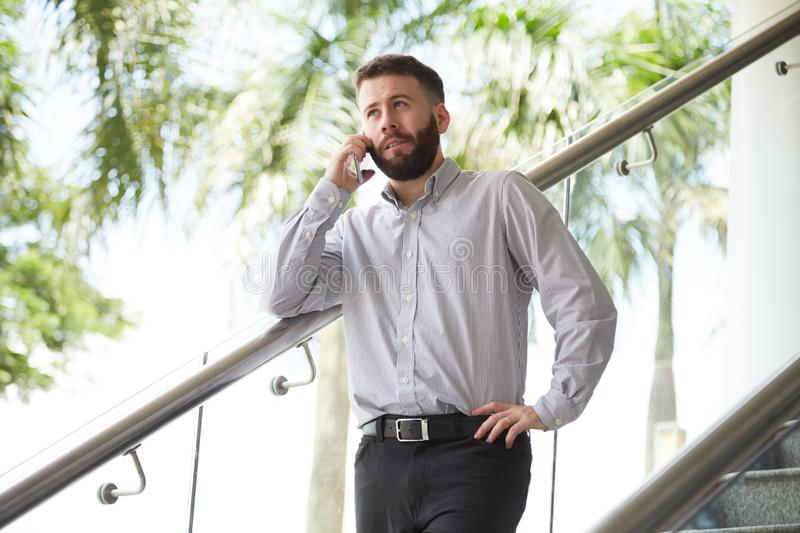 Manager talking on mobile phone stock photography
