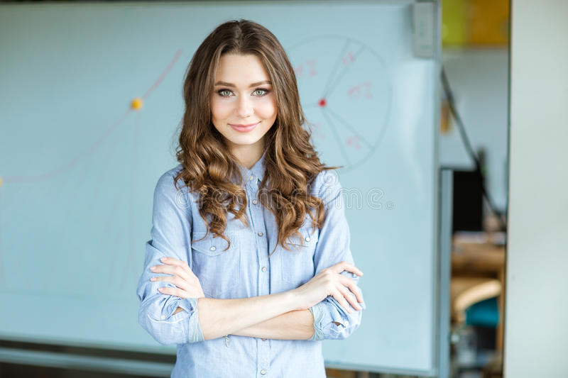 Confident beautiful curly business woman stock photos