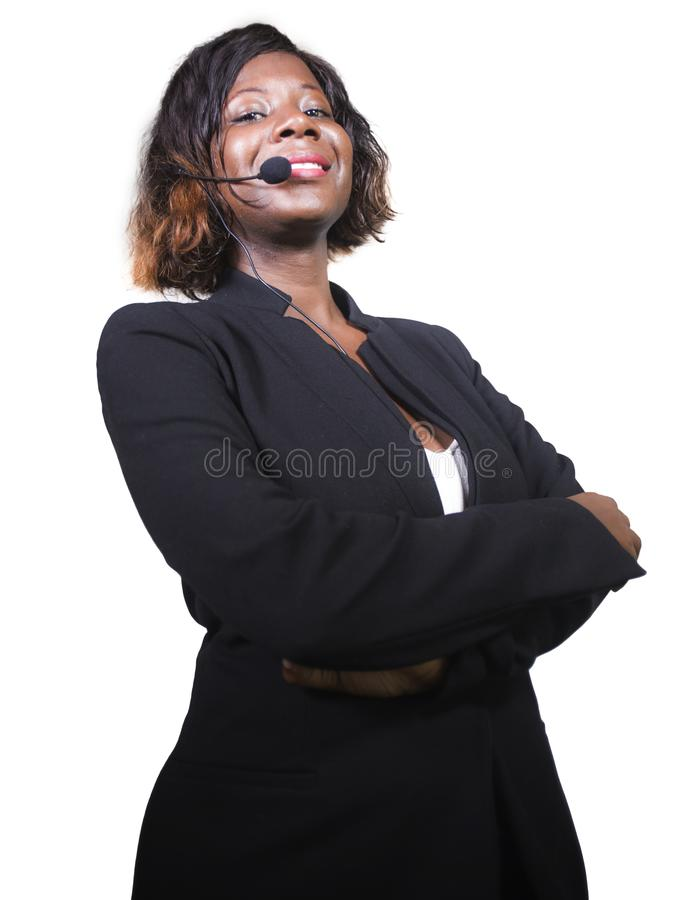 Confident black African American business woman with headset speaking at corporate seminar event in motivation coaching conference. Young attractive and royalty free stock photos