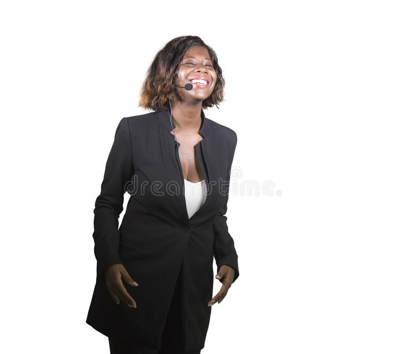 Confident black afro American business woman with headset speaking at corporate seminar event in motivation coaching conference. Young attractive and confident stock photo