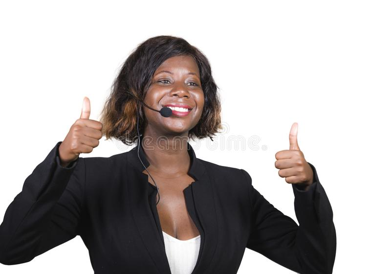 Confident black afro American business woman with headset speaking at corporate seminar event in motivation coaching conference. Young attractive and confident royalty free stock image