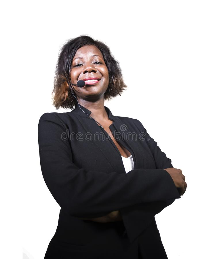 Confident black afro American business woman with headset speaking at corporate seminar event in motivation coaching conference. Young attractive and confident royalty free stock images