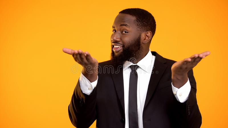 Confident black male inviting for investment, making business offer, promotion stock photos