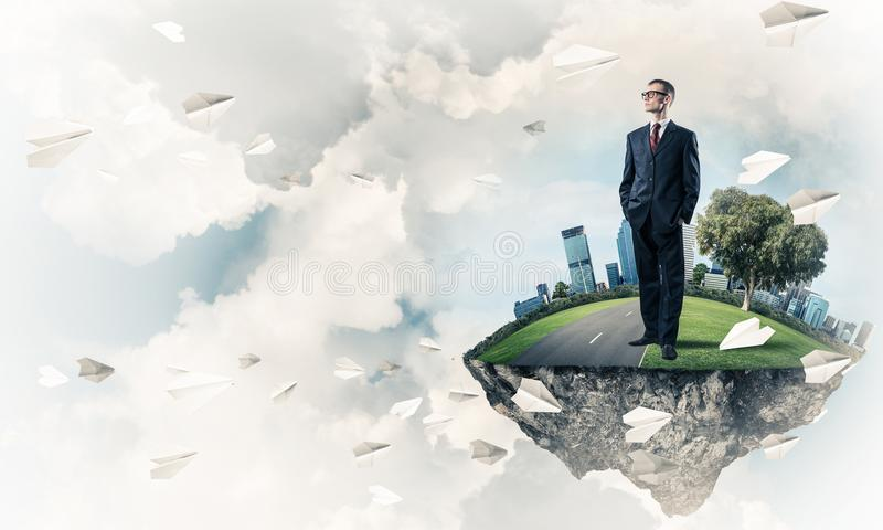 Confident boss and modern city as concept of eco green construct. Elegant confident businessman standing on green floating island in blue sky stock illustration