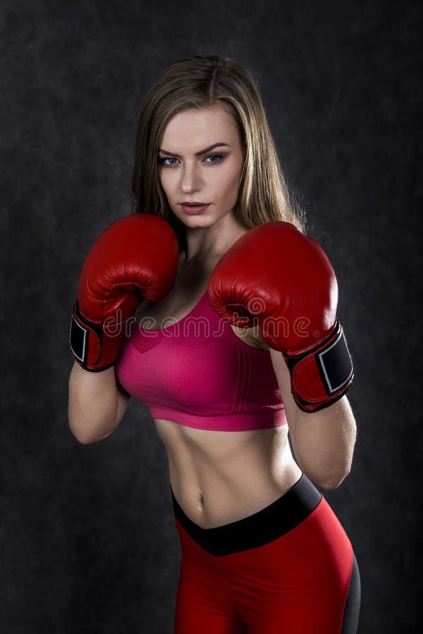 Free Confident Boxing Woman In Red Box Gloves Royalty Free Stock Images - 87700029