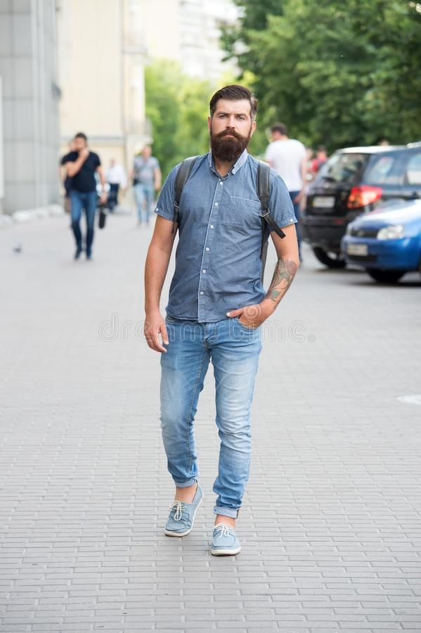 Confident brutal man walk street. Male barber care. brutal hipster with moustache. adventure concept. urban style. Commit to travel. Mature hipster with beard royalty free stock photo