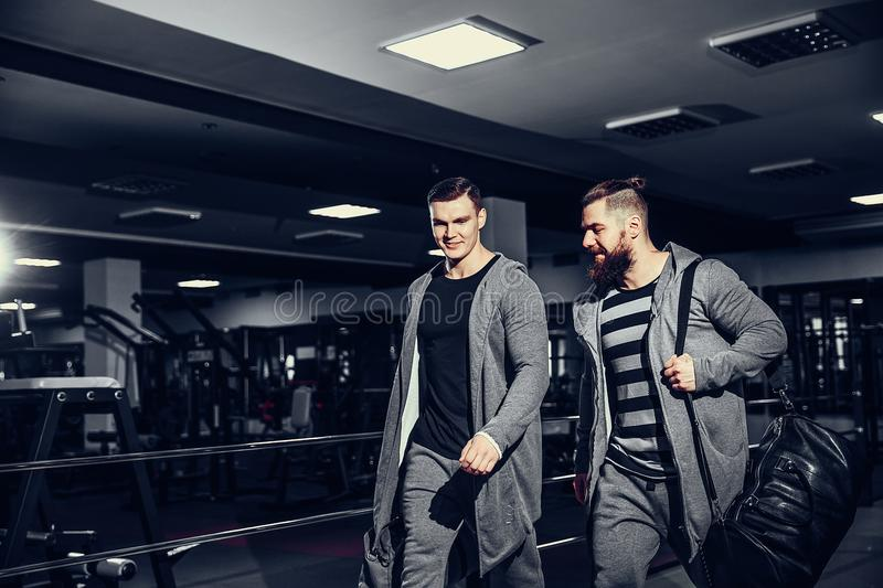 Confident young sportsmen leaving gym royalty free stock photos