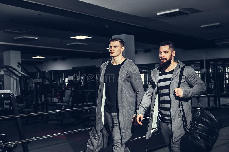 Confident young sportsmen leaving gym stock images