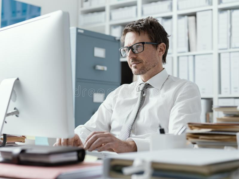 Confident business executive working in the office royalty free stock images