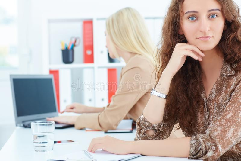 Young confident business expert with female colleague on the background. Business and partnership, job offer concept. royalty free stock photos