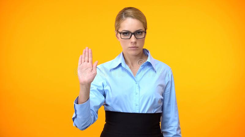 Confident business lady showing stop gesture hand, professional ethics, control. Stock photo stock image