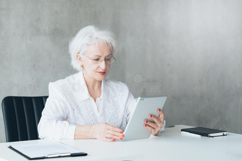 Confident business lady tablet digital analysis stock photography