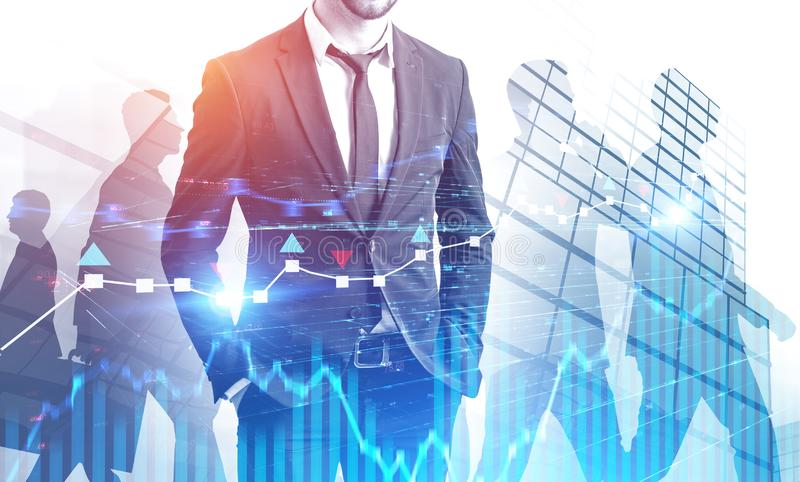 Confident business leader in city, forex graphs stock image