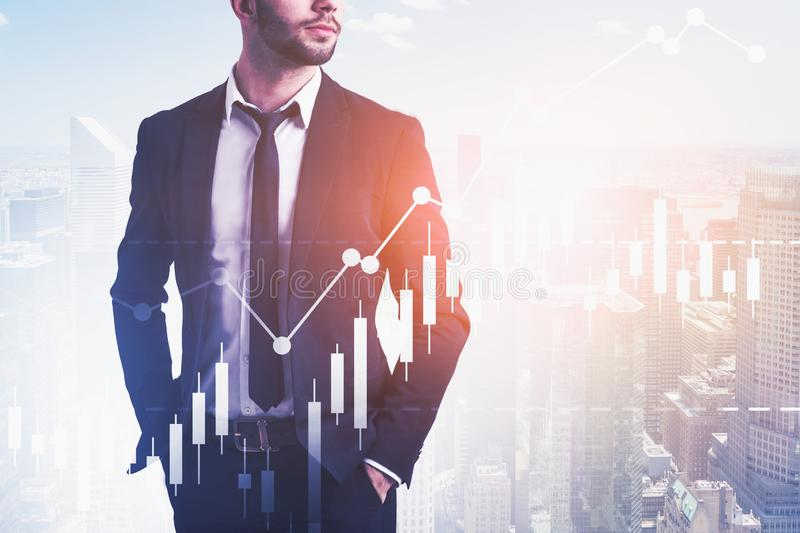 Confident business leader in city, graphs stock images