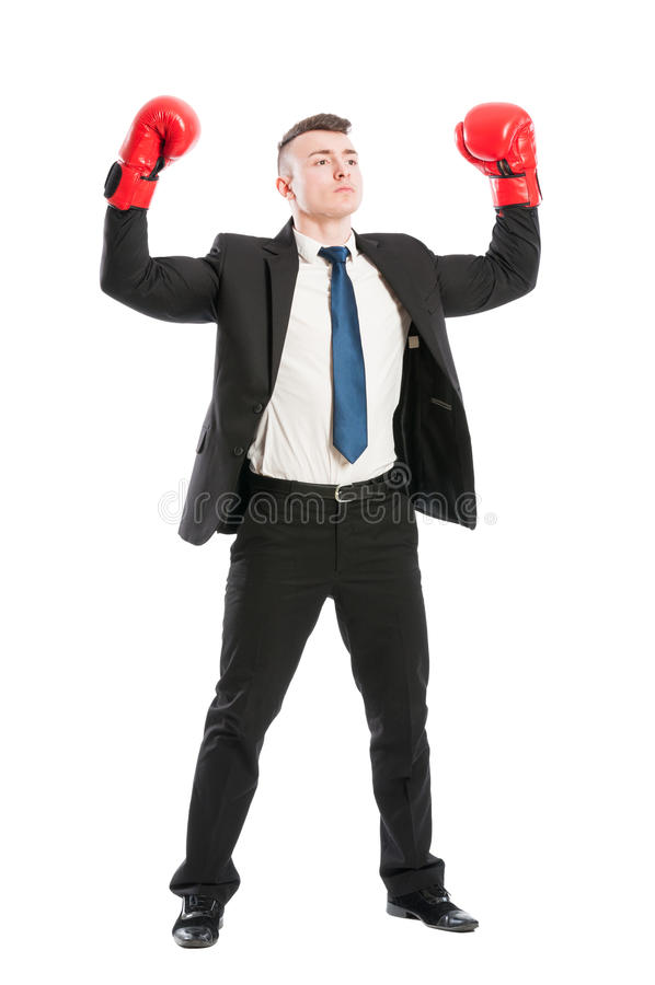 Confident business man acting like a champion. Successful businessman concept with red boxing gloves royalty free stock photography