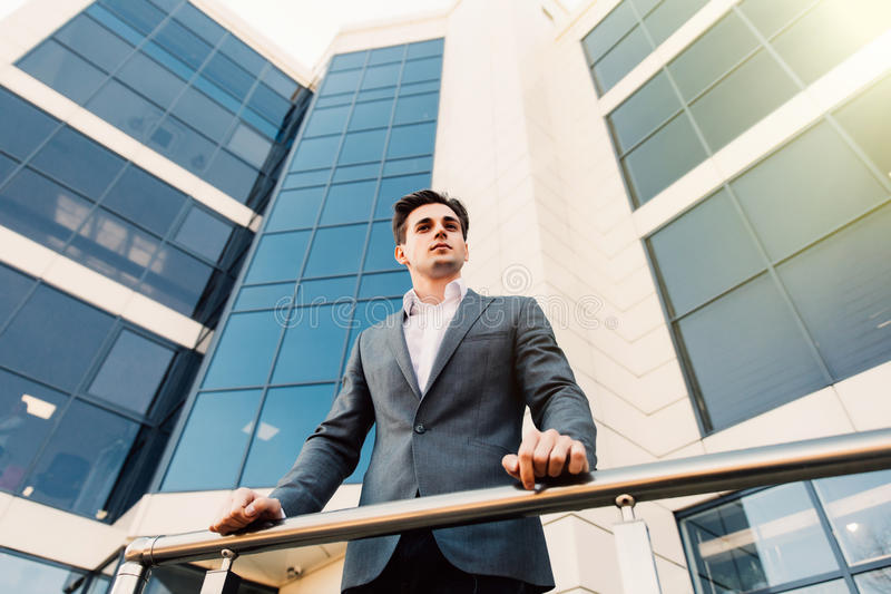 Confident business man leader in front of building office. Confident business man leader in front of glasses building office stock photos
