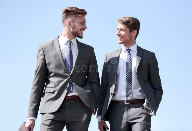 Confident business partners walking together. royalty free stock photography