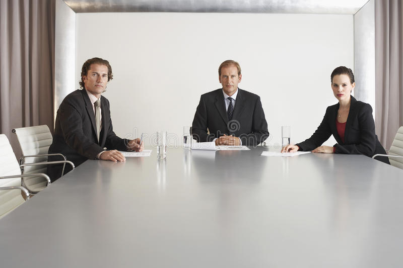 Confident Business People In Conference Room royalty free stock images