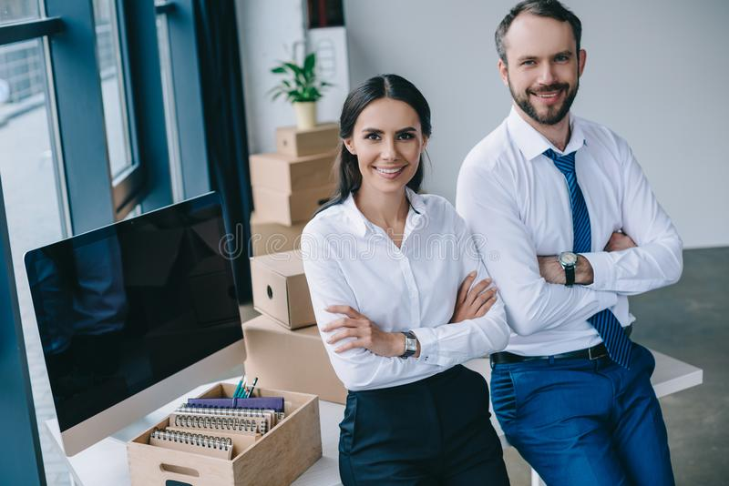 confident business people with crossed arms smiling at camera royalty free stock images