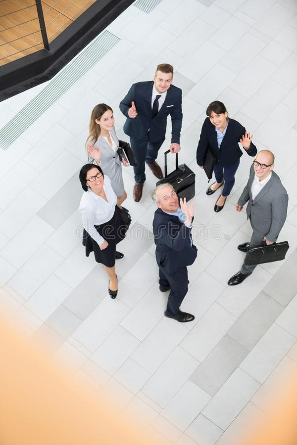 Confident Business People Gesturing In Office Lobby royalty free stock photos