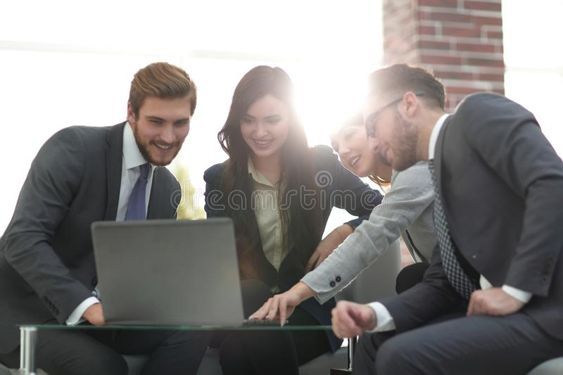 Beautiful business people are using a laptop during the conferen stock photo