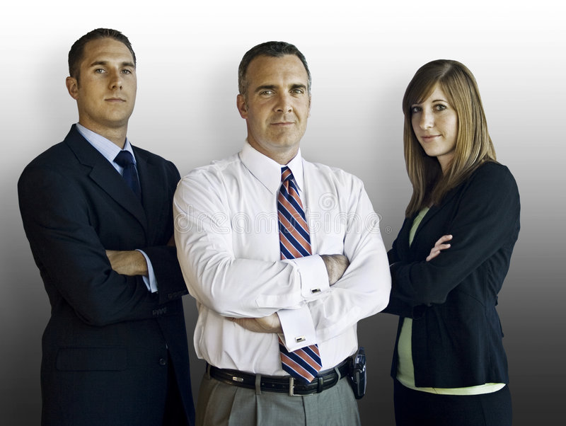 Confident Business Team. A confident business team isolated on a simple background. Clipping path included stock photo