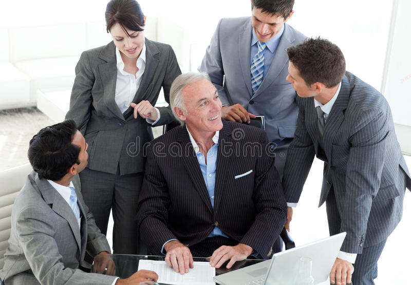 Download Confident Business Team Discussing A Contract Stock Photo - Image: 12118756