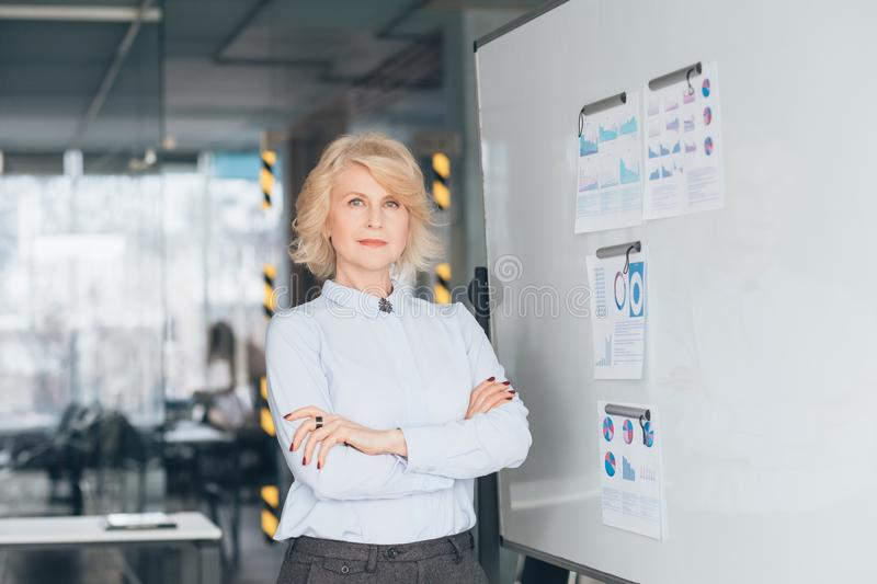 Confident business woman arms folded top coach royalty free stock photo