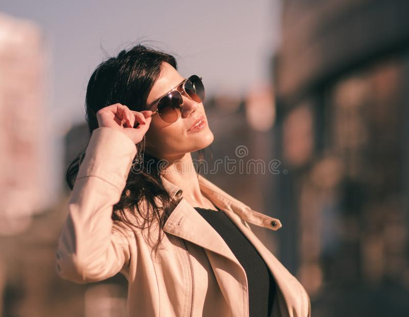 Confident business woman on the background of the big city stock photos