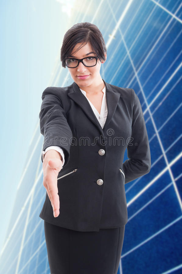 Confident business woman doing welcoming gesture stock photo