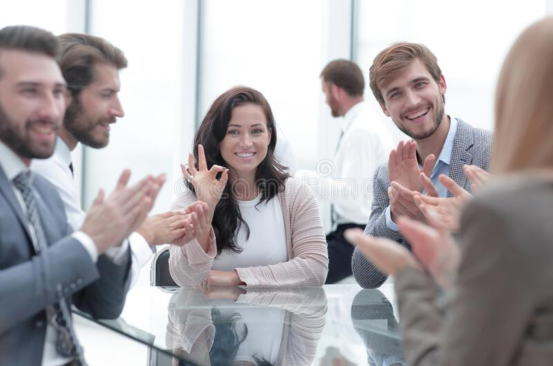 Confident business woman explaining something to her business partners. Confident business women explaining something to her business partners . business concept stock images