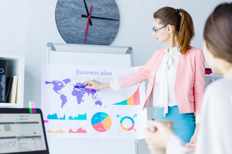 Confident business woman on business meeting at office stock photo