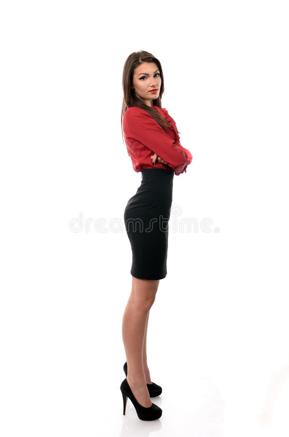 Confident business woman posing with her arms folded. Isolated on white stock image