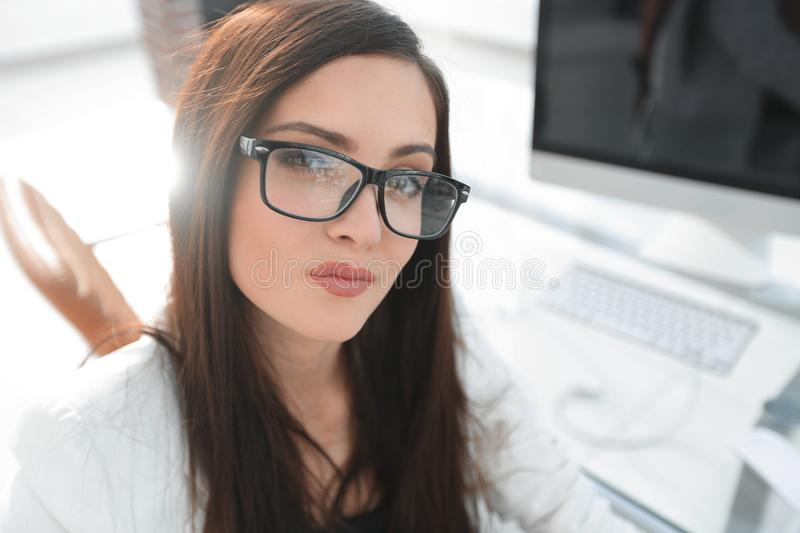 Confident business woman sitting at her Desk stock photo
