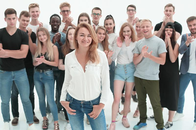 Confident business woman standing in front of a young business team royalty free stock photos