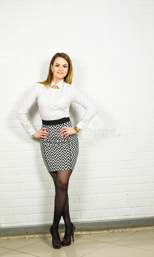 Confident business woman standing full length. Businesswoman or real estate agent indoors. Confident business woman standing full length. Businesswoman or real royalty free stock photography