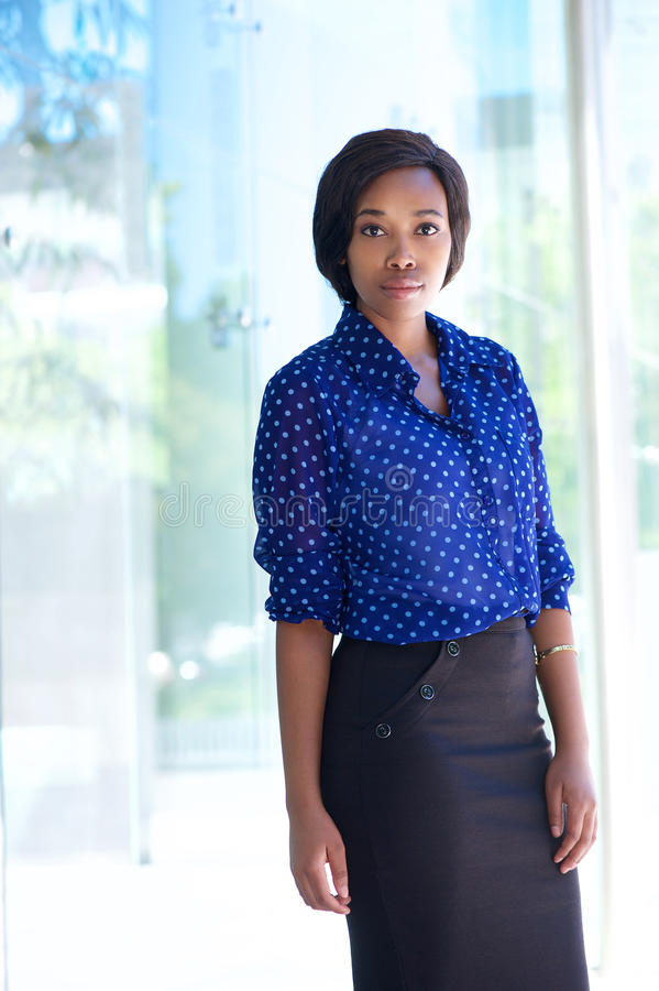 Confident business woman standing outside office building stock photo