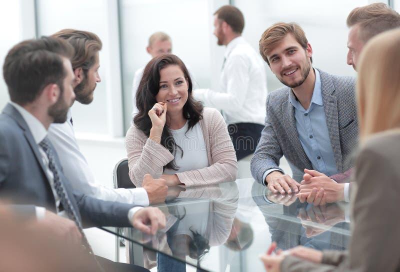 Confident business woman explaining something to her business partners. Confident business women explaining something to her business partners . business concept royalty free stock photo