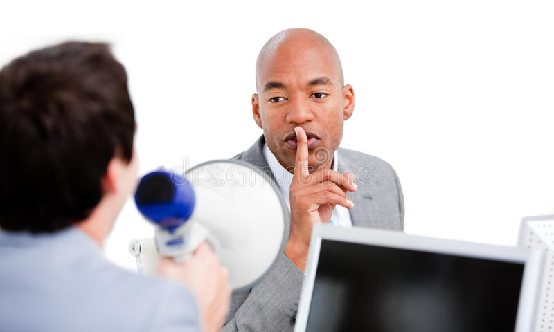 Confident businessman asking for silence stock photos
