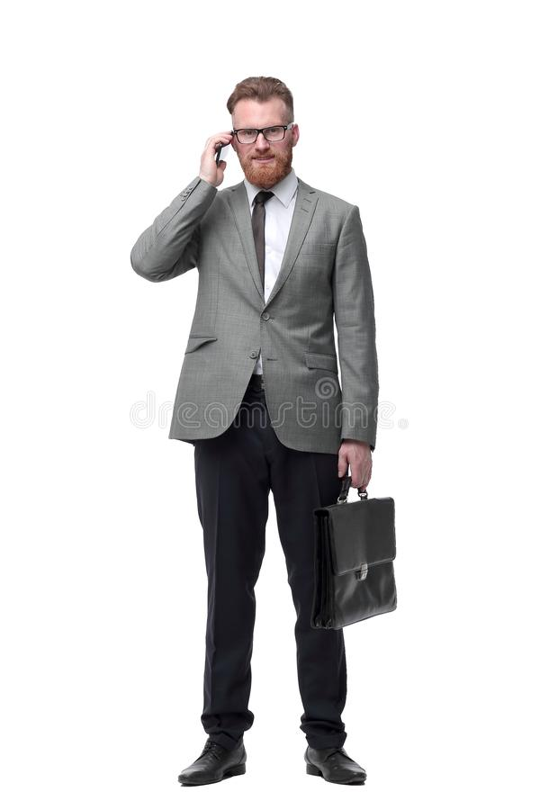 Confident businessman with briefcase . isolated on white background royalty free stock photo