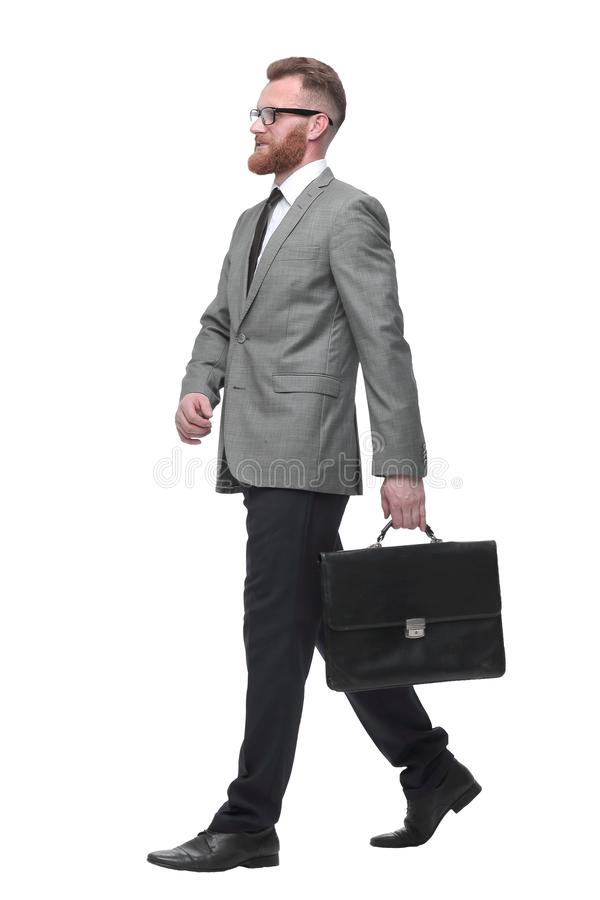 Confident businessman with briefcase stepping forward. isolated on white stock photo
