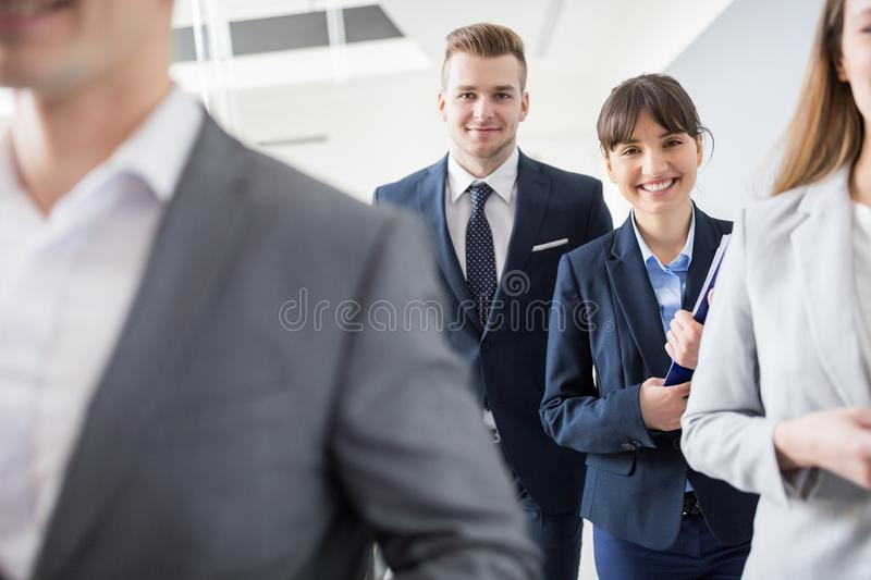 Confident Businessman And Businesswoman Smiling While Walking Wi royalty free stock images