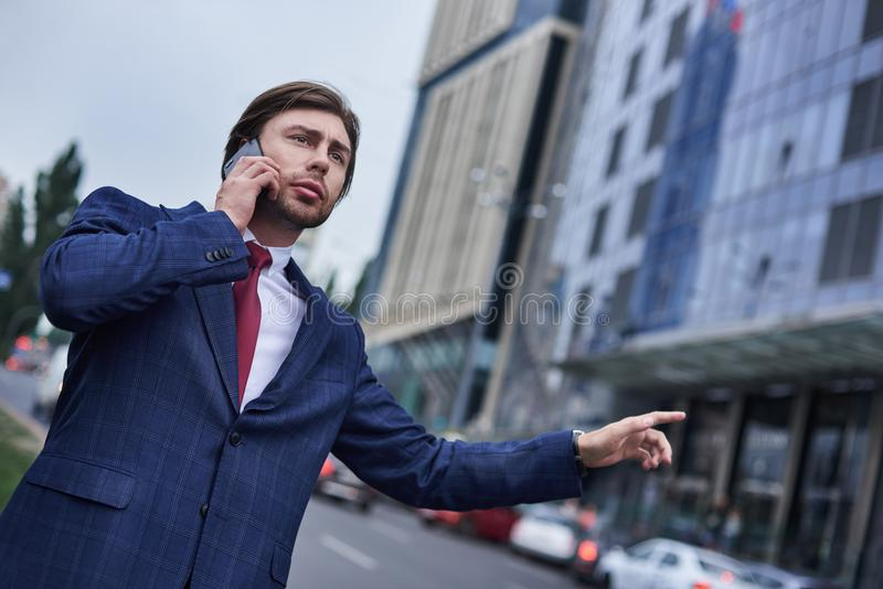 Confident businessman caching taxi royalty free stock photos