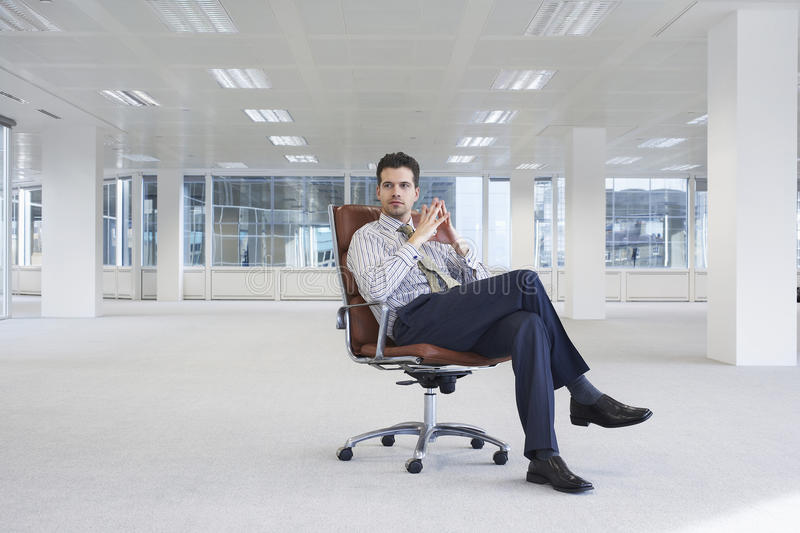 Download Confident Businessman On Chair In New Office Stock Image - Image of full, alone: 33896963